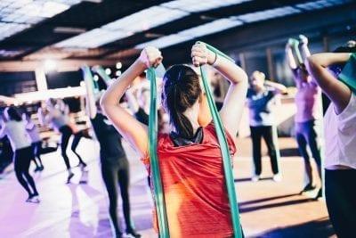 woman doing exercise to improve sleep cycle