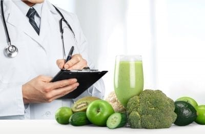 holistic doctor functional medicine with fruits and vegetables