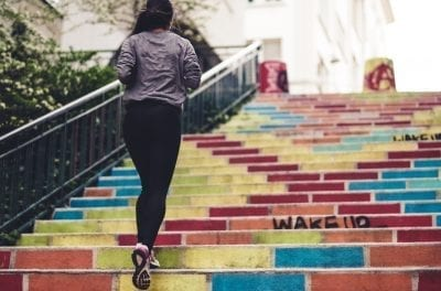 woman starting habit changes with fitness exercise at stairs