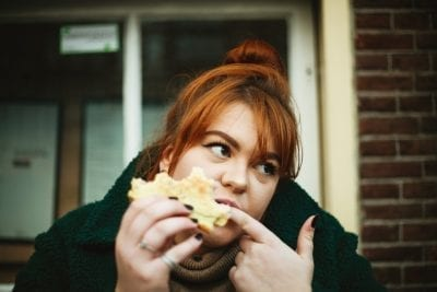 woman eating bread high blood sugar