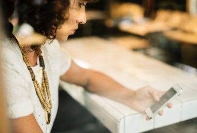 woman holding a phone stressed circadian rhythm