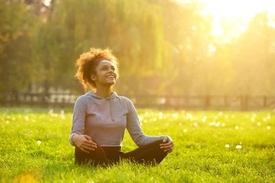 woman sitting on the grass gut type