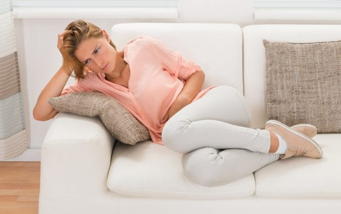 woman with Mold Illness laying on couch