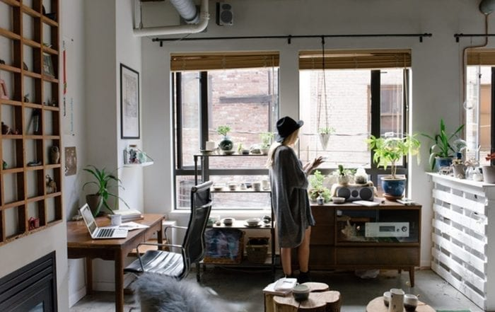 woman standing near the window checking for mold exposure