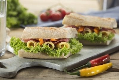sandwich with vegetables and meat eating healthy