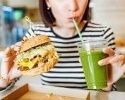 woman eating burger, smoothie food cravings