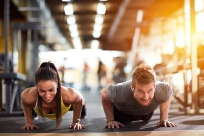 man and woman doing exercise routines gut health