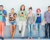 Millennials watching on their smart mobile phones
