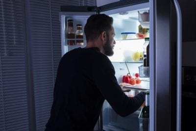 man searching the refrigerator, food myths