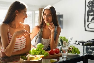 women eating apples, vegetables, gut loving superfoods