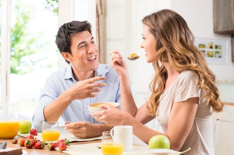 a man and a woman eating together, intuitive eater