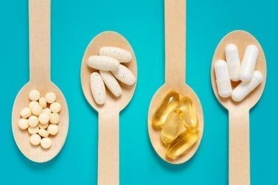 healthy supplements in spoons to boost metabolism