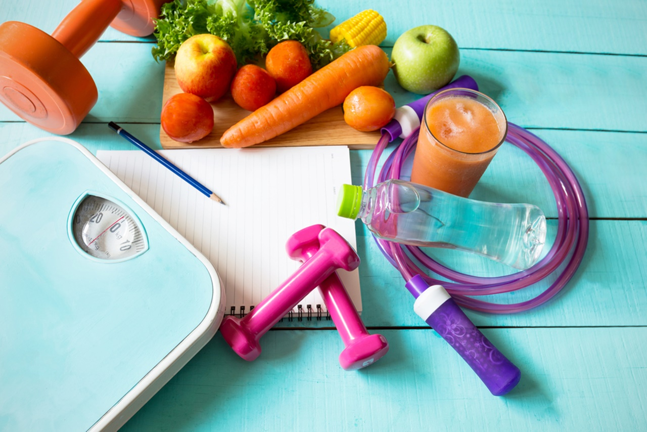 fruits, vegetables, juice in the glass, paper, weighing scale, boost metabolism naturally