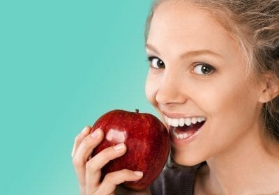 woman eating apple as food reintroduction